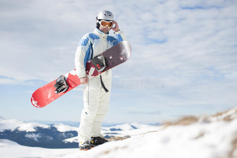 Man with snowboard royalty free stock images