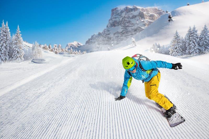 Man snowboarder riding on slope. stock photos
