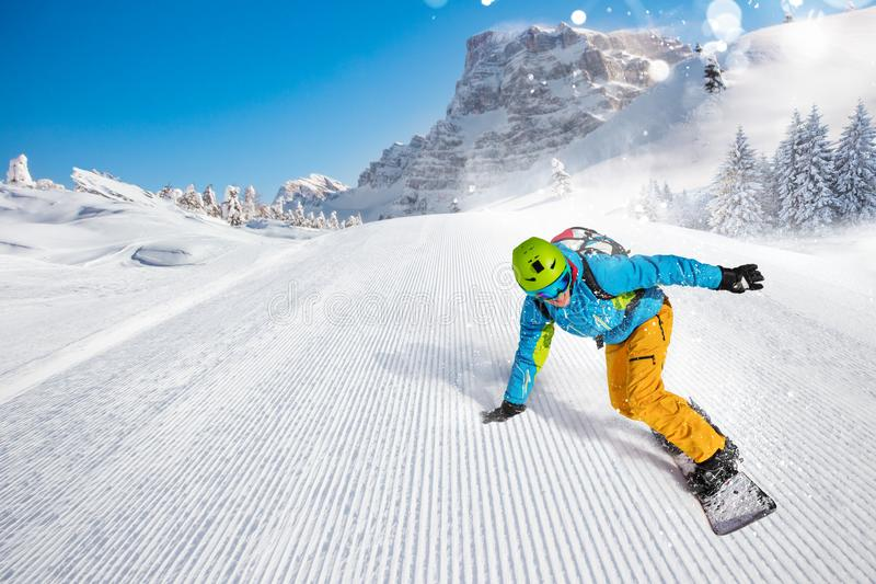 Man snowboarder riding on slope. royalty free stock photo