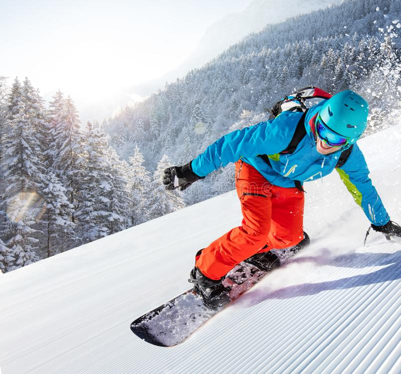 Man snowboarder riding on slope. stock images