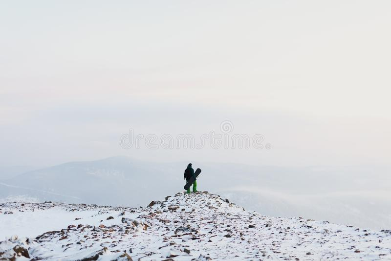 Man snowboarder in the winter mountains. Sport and active life stock photo
