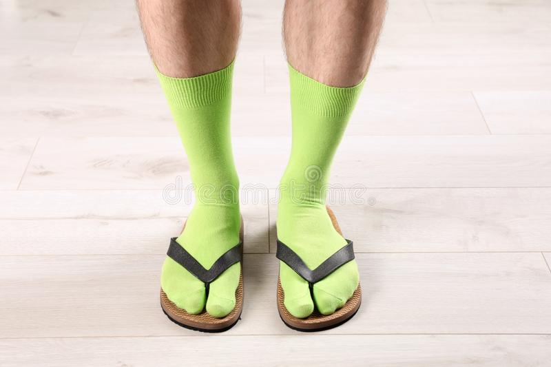 Man in socks and slippers on floor. Closeup royalty free stock photography