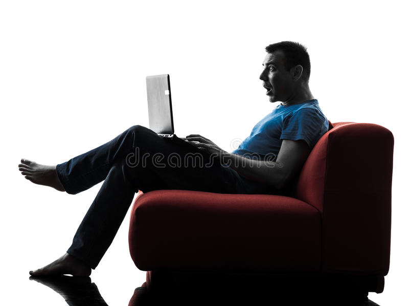 Man sofa couch computer computing laptop surprised royalty free stock image