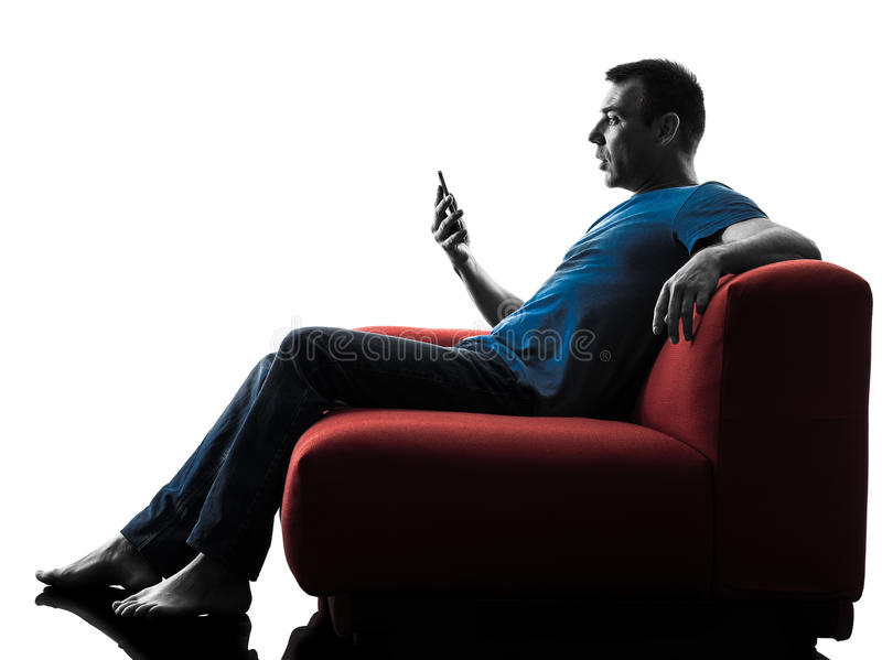 Man sofa couch. One caucasian man sofa couch in silhouette isolated on white background royalty free stock photo