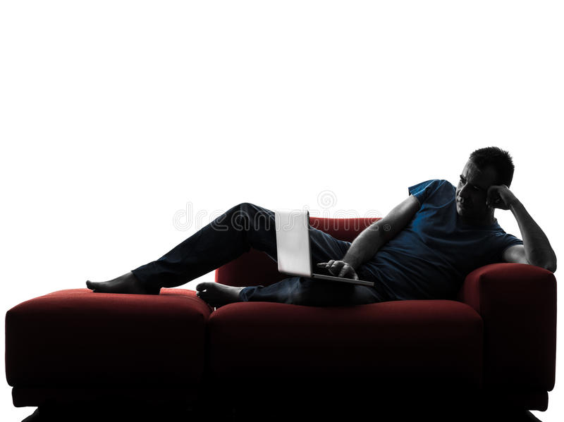 Man sofa couch. One caucasian man sofa couch in silhouette isolated on white background royalty free stock images