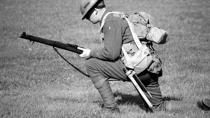 Man In Soldier Suit Holding Gun Knees Down In The Ground Free Public Domain Cc0 Image