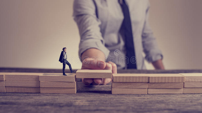 Man solving problems by building bridge with wooden block stock photos