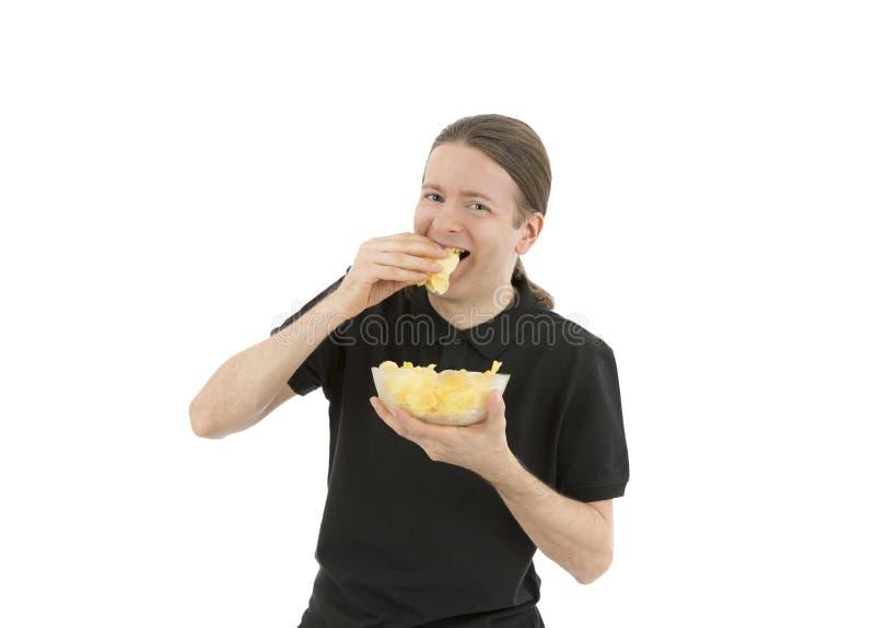 Man som äter mellanmålet arkivfoton