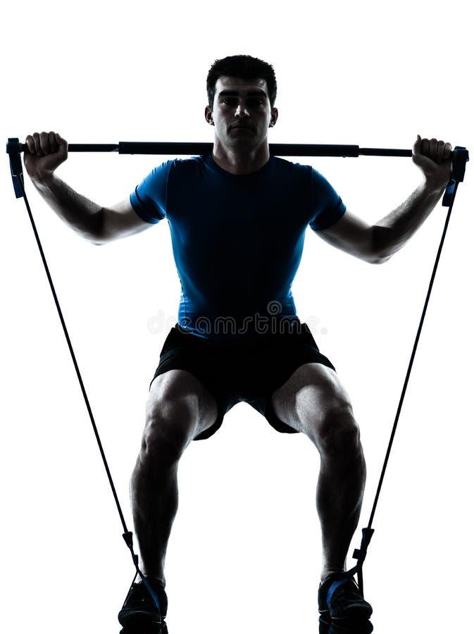 Man som övar ställing för gymstickgenomkörarekondition royaltyfri fotografi
