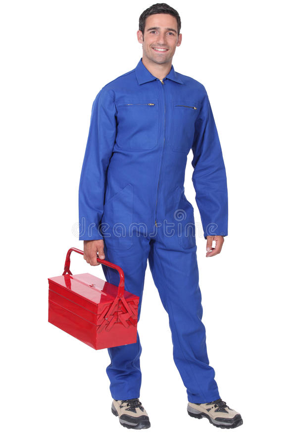 Man som bär blåa overaller royaltyfri bild