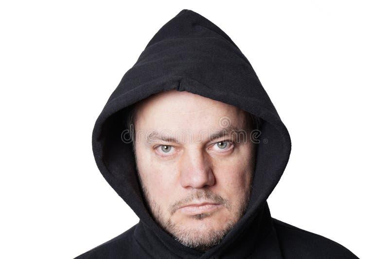 Man som bär den svarta hoodien royaltyfria foton