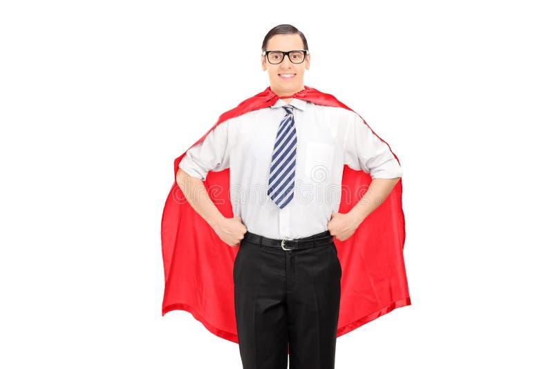 Man som bär en röd udde arkivfoton