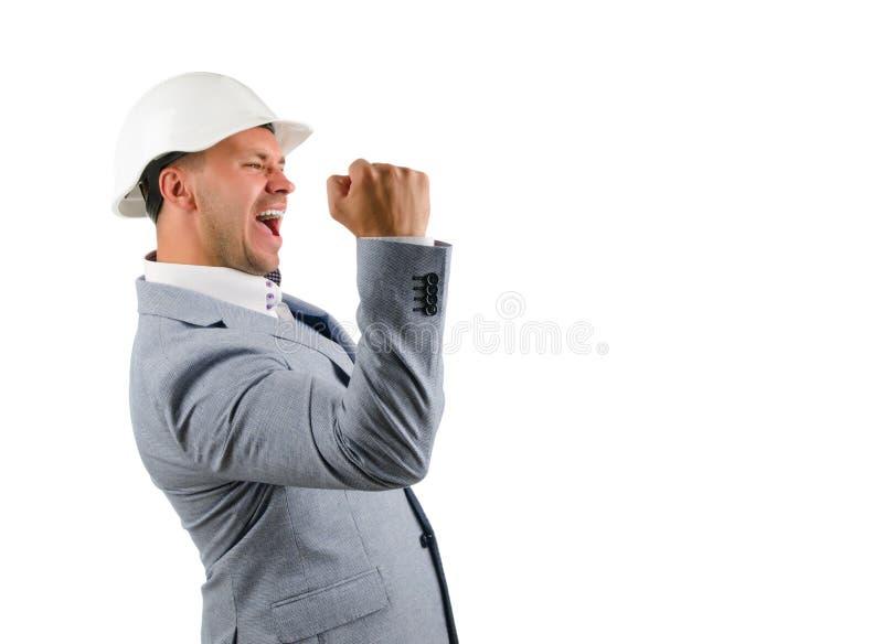 Man som bär ett hardhatbifall i jubel royaltyfri foto