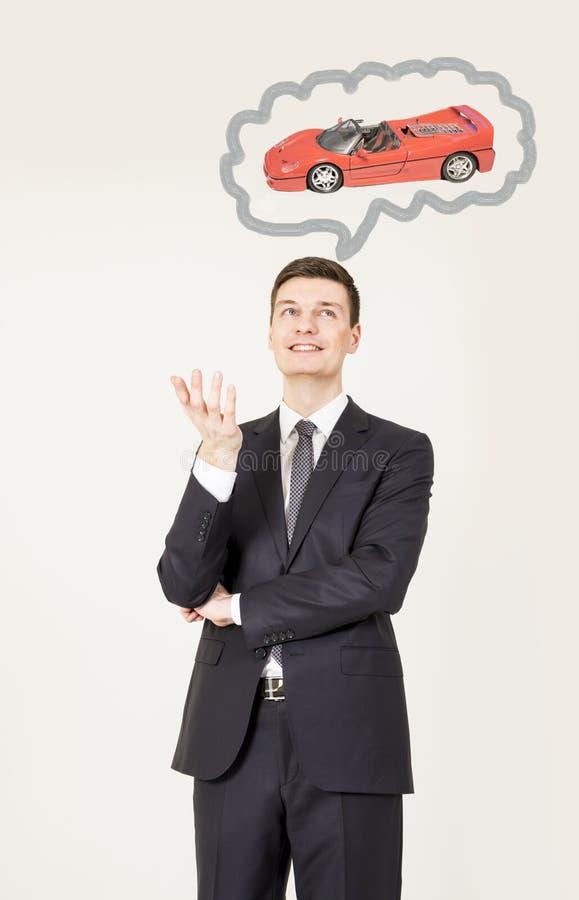 Man som drömmer om bilen royaltyfria bilder