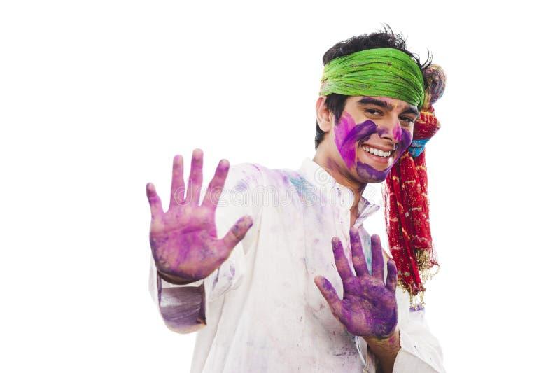 Man som firar Holi arkivfoto