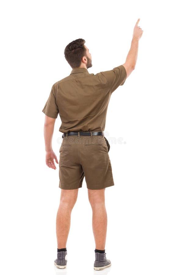 man som pekar upp isolated rear view white arkivbilder