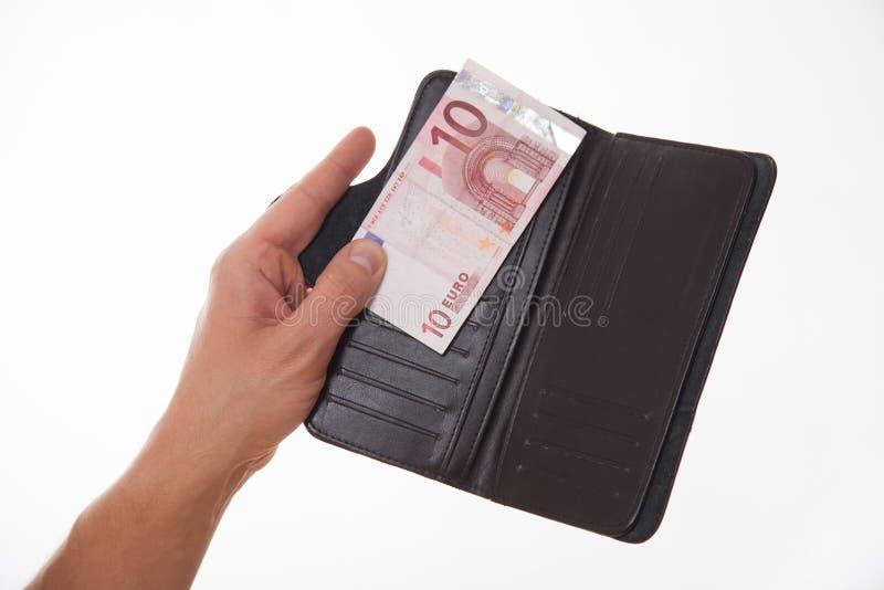 Man som rymmer en svart handväska med euro tio royaltyfri fotografi