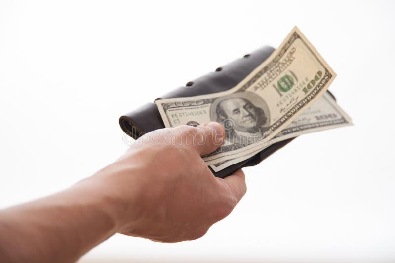 Man som rymmer en svart handväska med pengar arkivfoton