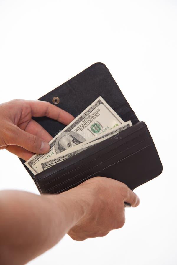 Man som rymmer en svart handväska och dollar royaltyfria foton