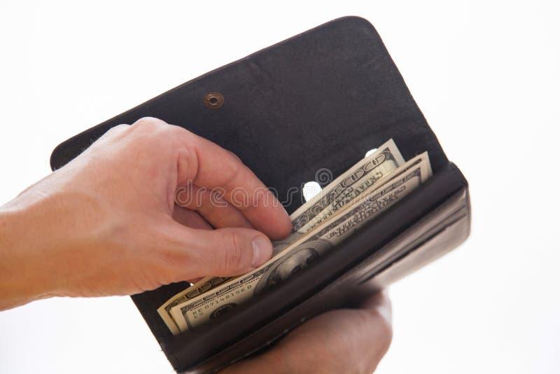 Man som rymmer en svarta handväska och pengar royaltyfria bilder