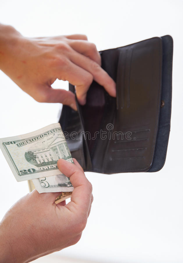 Man som rymmer en svarta handväska och pengar arkivfoto