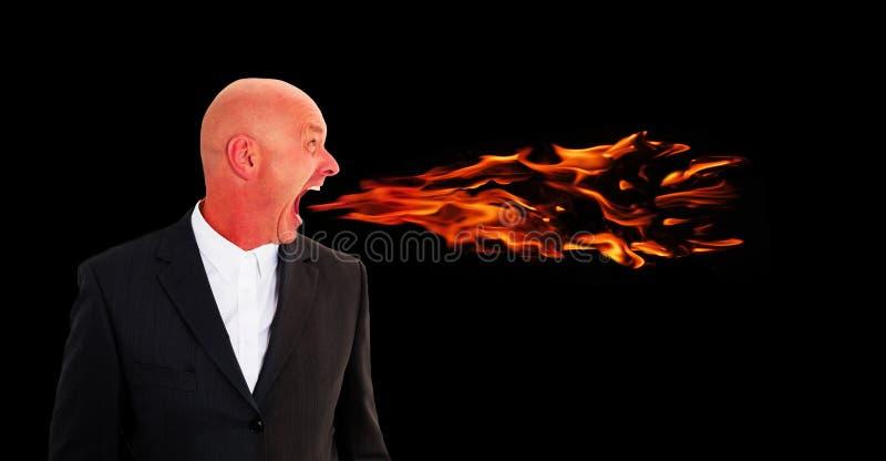 Man som skriker med flammor som kommer ut ur mun royaltyfri bild