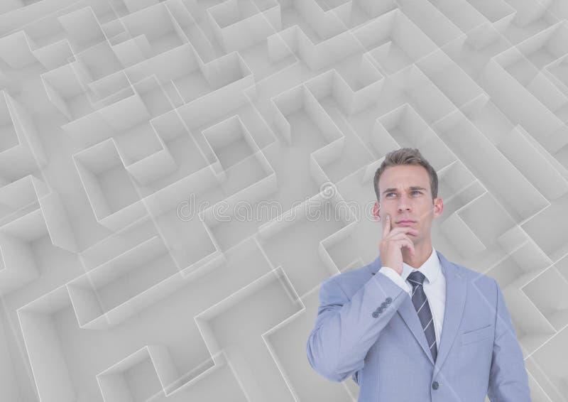 Man som tänker bak en labyrint arkivbild