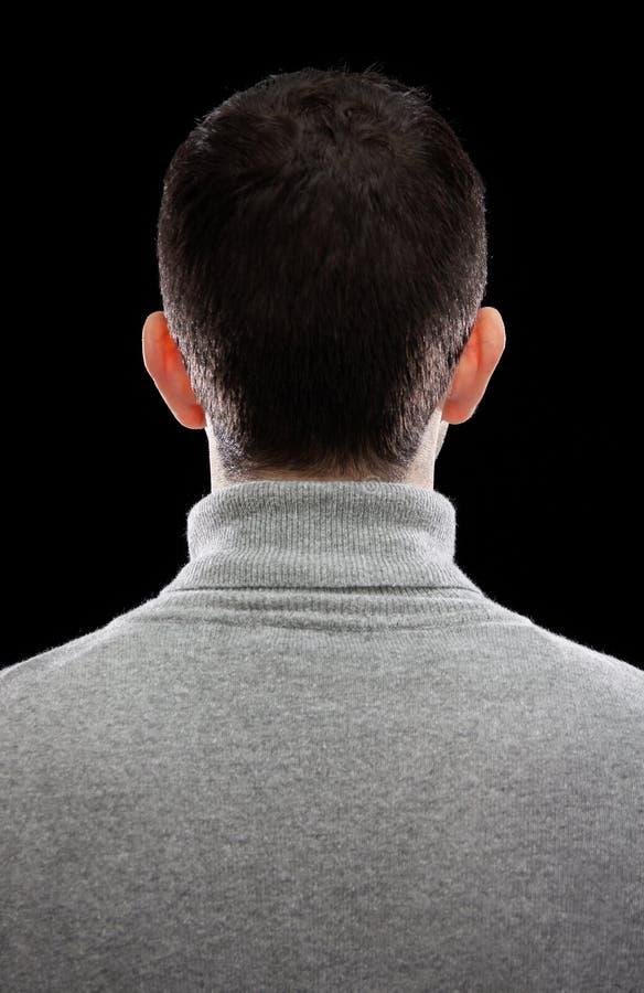 Man som vänder hans baksida royaltyfri foto