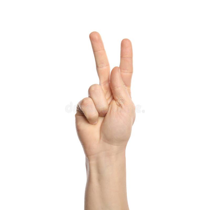 Man som visar K-bokstaven på vit bakgrund, closeup arkivfoto