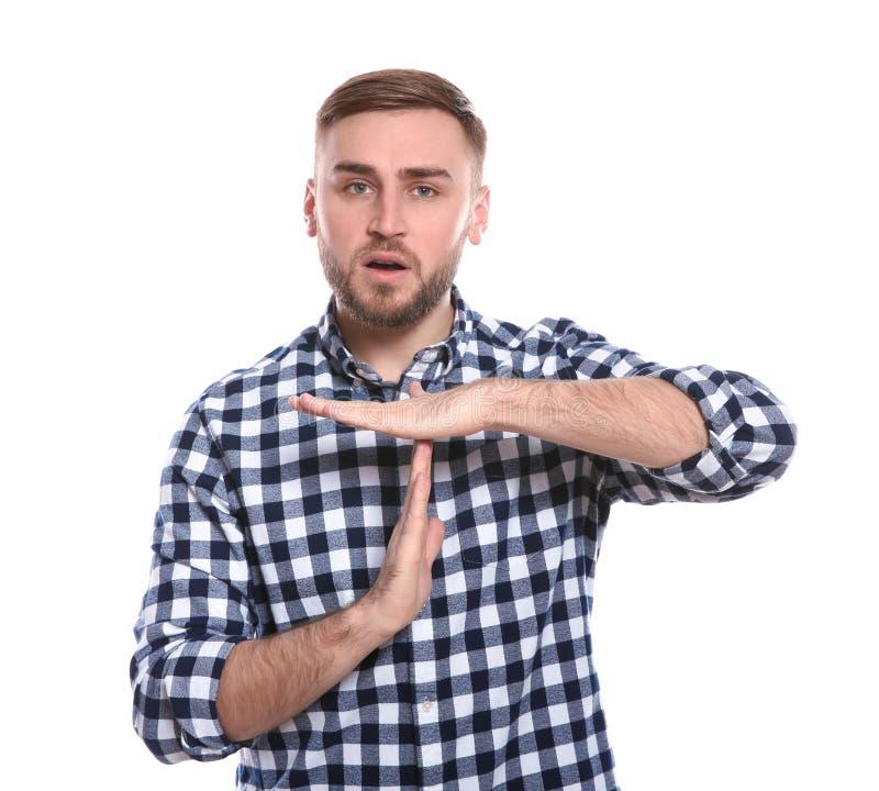 Man som visar TIME OUTgest i teckenspråk arkivfoton