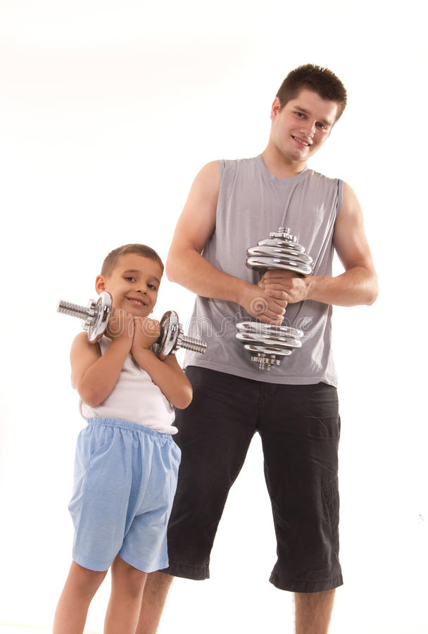 Download Man And Son Exercise At Gym Stock Photos - Image: 20235923