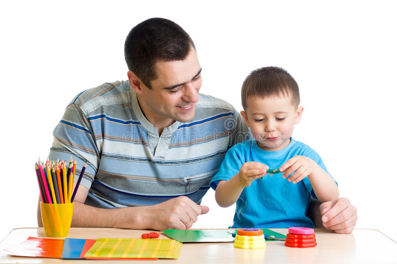 Man and son play clay together stock images
