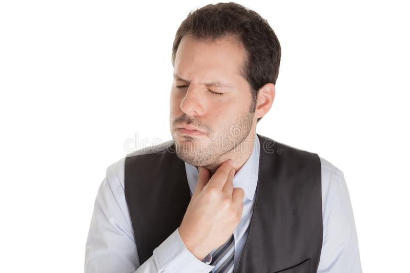 Man with sore throat isolated on white background. Disease, influenza and infection concept stock photography