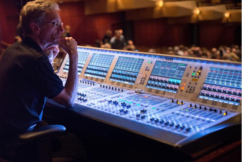 Man at sound mixing console stock photo