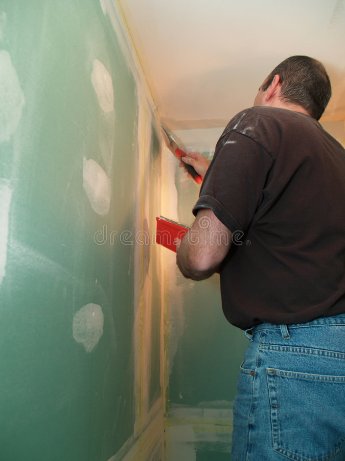 Download Man spackling new drywall stock photo. Image of inside - 5789896