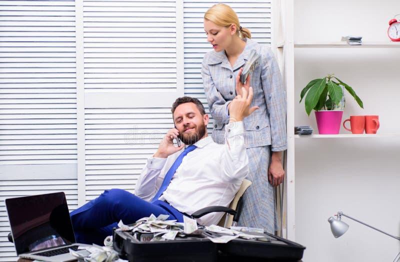 Man speak on phone. business success. couple count money. handsome businessman millionaire with secretary. successful stock images