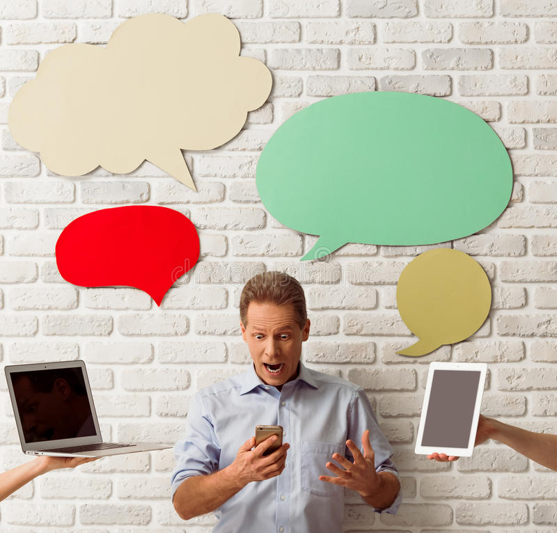 Man with speech bubbles stock images