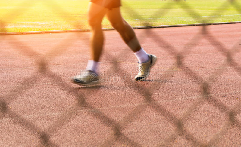 Man speed motion Running on track in Sport Stadium stock photo