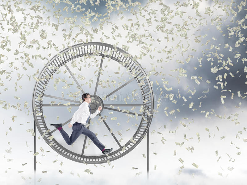 Man in spinning wheel royalty free stock photos
