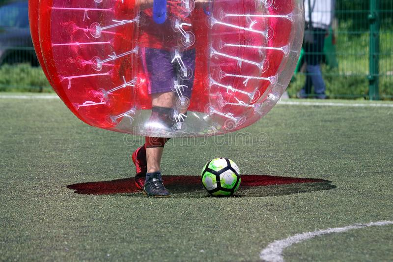 Man on a sports field playing in the bumper ball stock images