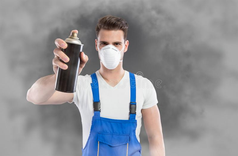 Man spray toxic gas stock images
