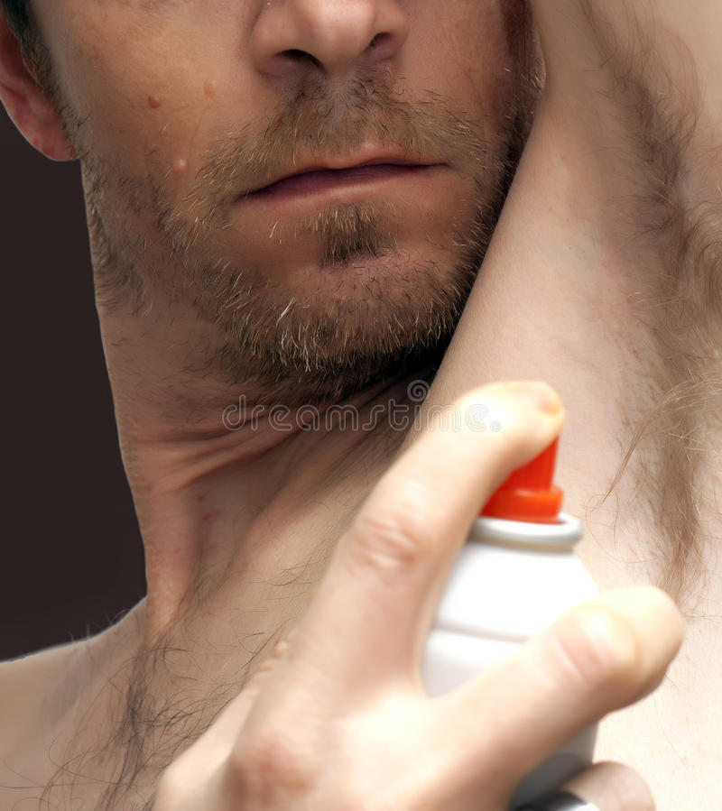Man Spraying Deodorant Royalty Free Stock Photo