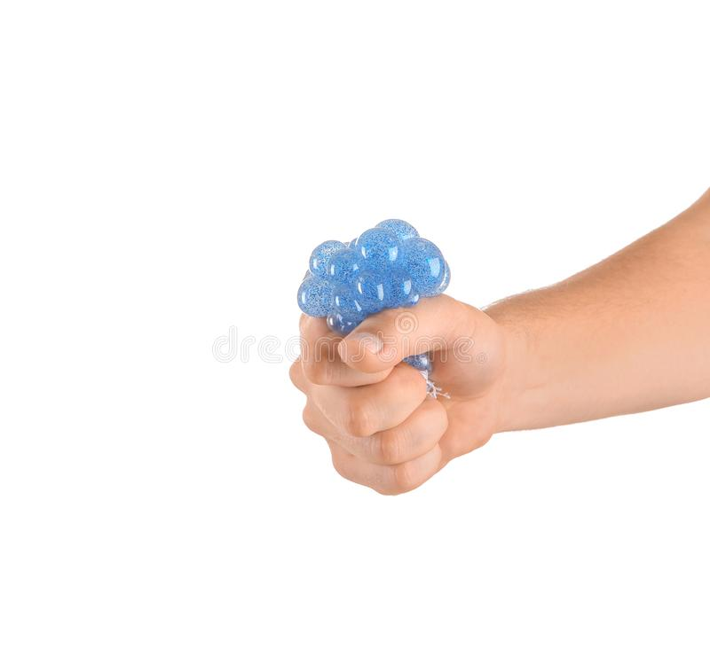 Man squeezing stress ball on white background royalty free stock images