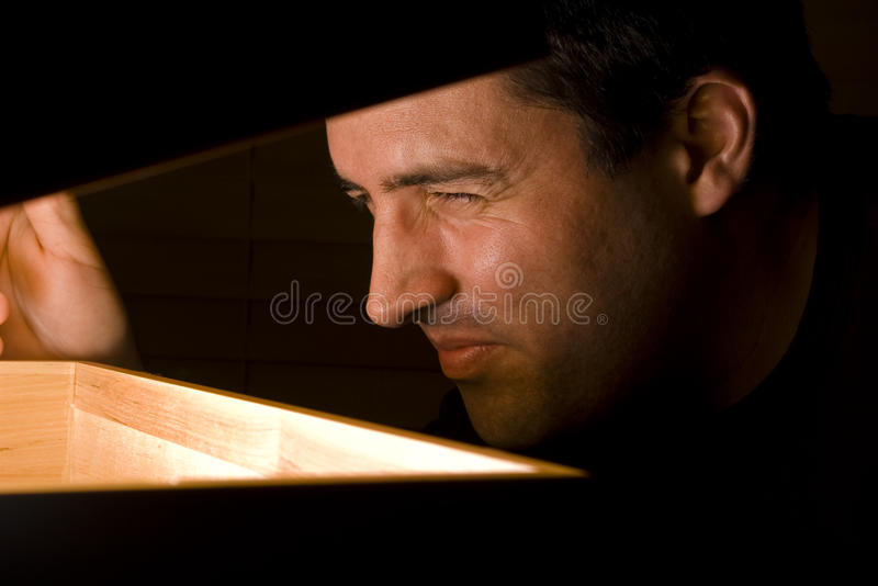 Man Squints At A Discovery Stock Photos