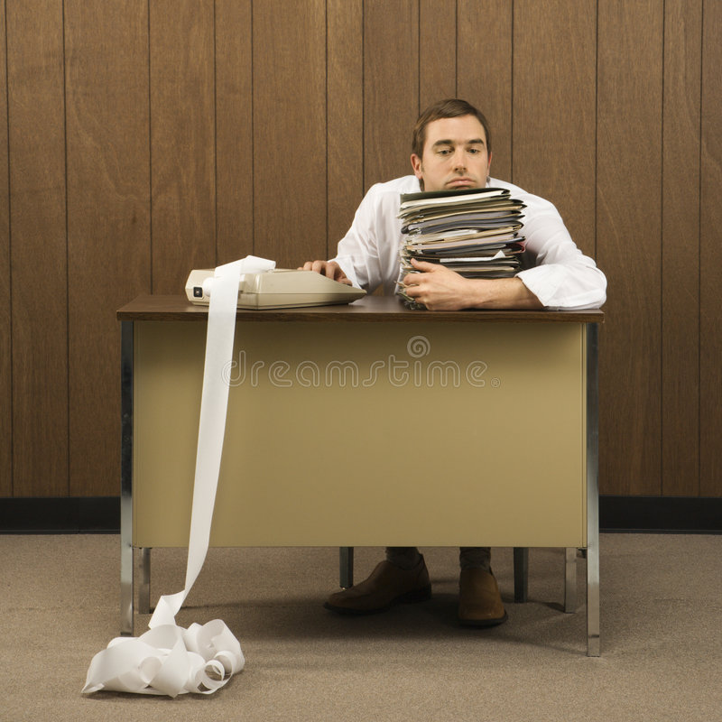 Man with stack of paperwork royalty free stock photos