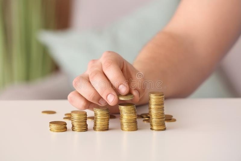 Man stacking coins on table. Savings concept royalty free stock photos
