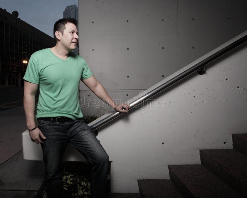 Man by a staircase stock photos