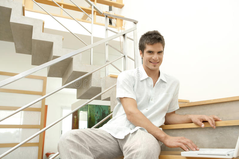 Man on Stairs with Laptop stock image