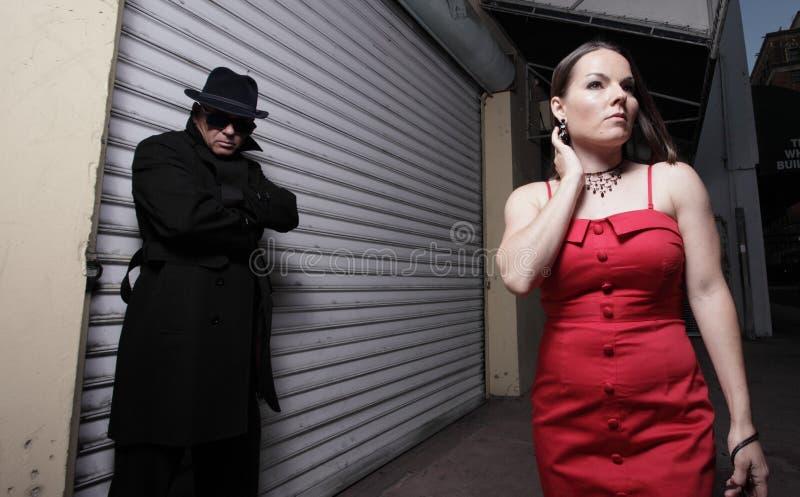 Man stalking the woman stock photos