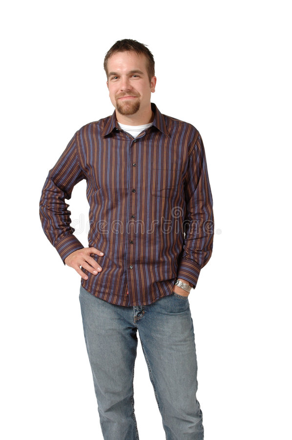 Man Standing. With his hand in his jeans pocket royalty free stock image